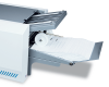 Integrated output conveyor keeps processed forms neat and sequential, ready for mailing
